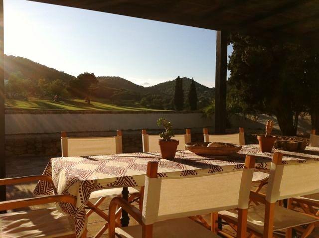 Roca-Llisa-dining-area-with-landscape-view-finca
