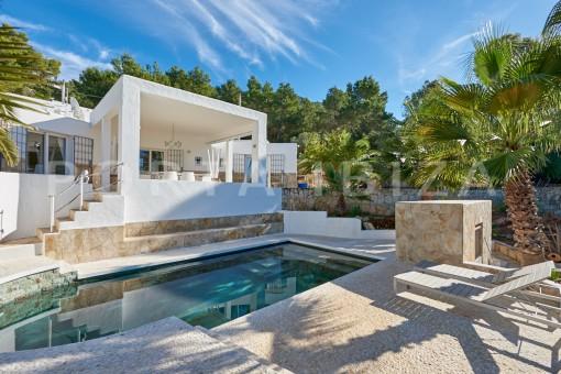 pool area and villa